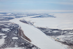 River in winter tundra from above Stock Photos