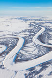 River in winter tundra from above Stock Images