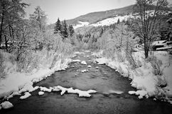 River during winter in val pusteria. River covered with snow during winter in val pusteria Royalty Free Stock Photography