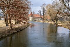 Free River With Trees, With Svihov Castle Near Klatovy In Czechia In The Background Stock Image - 212553551