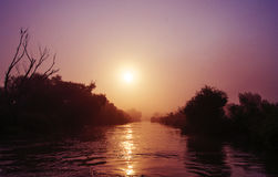 River with wooded shores and sunsrise Stock Photo