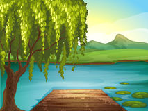 A river and a wooden bench Royalty Free Stock Photo