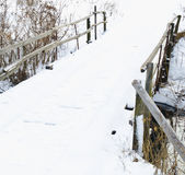 River with wooden bridge on winter day Stock Photography