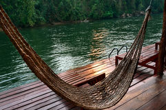 River. Wooden pier to relax on the River Kwai in the jungle of Thailand during sunset royalty free stock photos