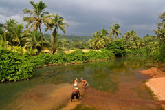 River workers. In Goa, India Stock Photography
