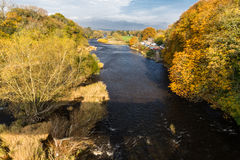 River Wye in Autumn at Hay on Wye. River Wye at Hay on Wye in October autumn fall, with coloured trees. Shadow of bridge Stock Photography