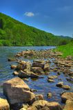 The River Wye - Wye Valley - England/Wales. Scenic view of river Wye on border between England and Wales with rocks in foreground Stock Photo