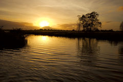 riverbank ηλιοβασίλεμα Στοκ Εικόνα