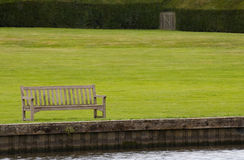 Riverbank bench Stock Photos