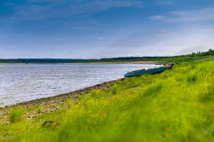 Riverbank with boats. Boats on the river bank of North Dvina Stock Photos