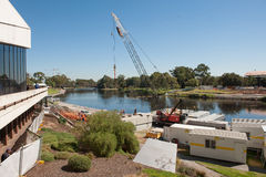 Riverbank Footbridge construction Stock Image