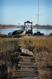 Riverbank path to boat Stock Image