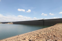 Riverbank and wall of dam in Thailand Royalty Free Stock Photos