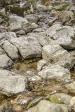 A riverbed with big rocks Stock Photo