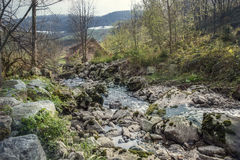 A riverbed with big rocks Stock Images