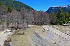 Riverbed in the mountains Stock Images