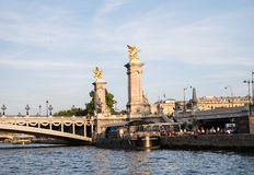 A riverboat bistro under the Pont Alexandre III on the Seine in Stock Photos