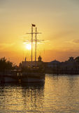Riverboat at sunset. River ship on sunset sky background with sun and clouds Stock Photo