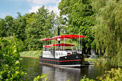 Riverboat tied to dock. A view of a tourist riverboat tied to a dock in Spala, Poland Royalty Free Stock Photos
