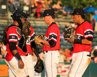 RiverDogs meet at the mound. Royalty Free Stock Photo