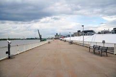 Riverfront promenade alongside Scheldt river outside of Het Steen, Antwerp Royalty Free Stock Image
