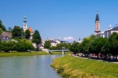 Salzburg, Austria riverfront. Riverfront of Salzburg, Austria on sunny day against blue skies royalty free stock photography