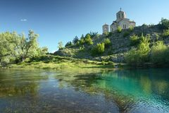 Riverhead of river Cetina in Croatia. And church Royalty Free Stock Image