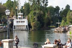 Rivers of America at Disneyland with Mark Twain Riverboat and raft. Disneyland's Rivers of America with the Mark Twain Riverboat exploring the river and Tom royalty free stock image