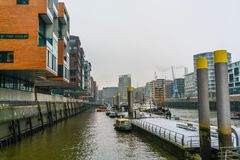 A gloomy and frosty winter day in the center of the port city of Hamburg. The rivers and canals of an ancient city in the center of Europe Stock Image