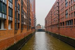 A gloomy and frosty winter day in the center of the port city of Hamburg. The rivers and canals of an ancient city in the center of Europe Royalty Free Stock Photo