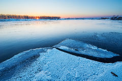 The rivers covered with ice sunset Royalty Free Stock Image