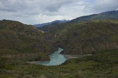 Rivers meeting along the Carretera Austral in Patagonia, Chile. Confluence of the Rio Chacabuco with the glacial blue waters of the Rio Baker along the Carretera Stock Images