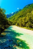 Rivers in the mountains with beautiful turquoise water. Soca River in Slovenia. Royalty Free Stock Photo