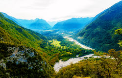 Rivers in the valley and hills in the background. Soca River in Slovenia. Royalty Free Stock Image
