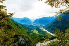 Rivers in the valley and hills in the background. Soca River in Slovenia. Royalty Free Stock Photography
