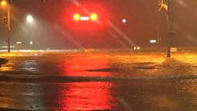 Rivers of water flowing down the city street, running traffic lights, after a tropical hurricane 2 stock video