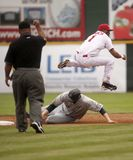 Riversharks. Rivershark shortstop Juan Francia leaps over Bridgeport's Joe Borchard after throwing to first to complete a doubleplay in the first inning of May Royalty Free Stock Images