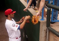 Riversharks. Former Phillie Pedro Feliz signs autographs for fans before May 18th Camden Rivershark game at Campbell Field, Camden. Feliz signed with the Royalty Free Stock Image