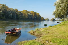 Riverside. Small boat at mooring on the riverside of Loire - Touraine, France Royalty Free Stock Photo