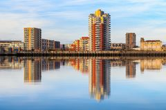 Riverside apartment next to Thames Barrier with its reflection f royalty free stock images