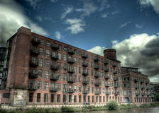 Riverside Apartments. Riverside mills converted into luxury apartments in Leed, WestYorkshire, UK. HDR Royalty Free Stock Image