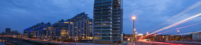 Riverside apartments. Huge riverside construction in London by night stock photo