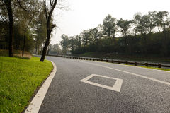 Riverside asphalted road in sunny winter afternoon Stock Photo