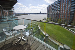 Riverside balcony with garden furniture