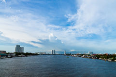 Riverside in bangkok with bridge and skyscrapers Stock Photo