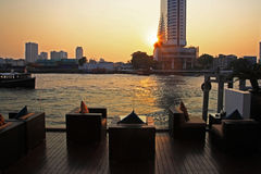 Riverside bar and restaurant near river, Bangkok. Riverside bar and restaurant near Chao phraya river during sunset in Bangkok, Thailand Royalty Free Stock Photo