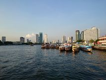 Riverside. Boat water sky city light stock image