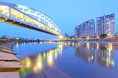 Riverside buildings and the famous HuanDong Rainbow Bridge over Keelung River at dusk in Taipei Taiwan, Asia stock photos