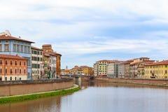 Riverside buildings at river Arno in Pisa, Italy Stock Photos