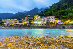 Riverside buildings in Wulai hot spring village. Riverside view of Wulai hot spring village at night Royalty Free Stock Image